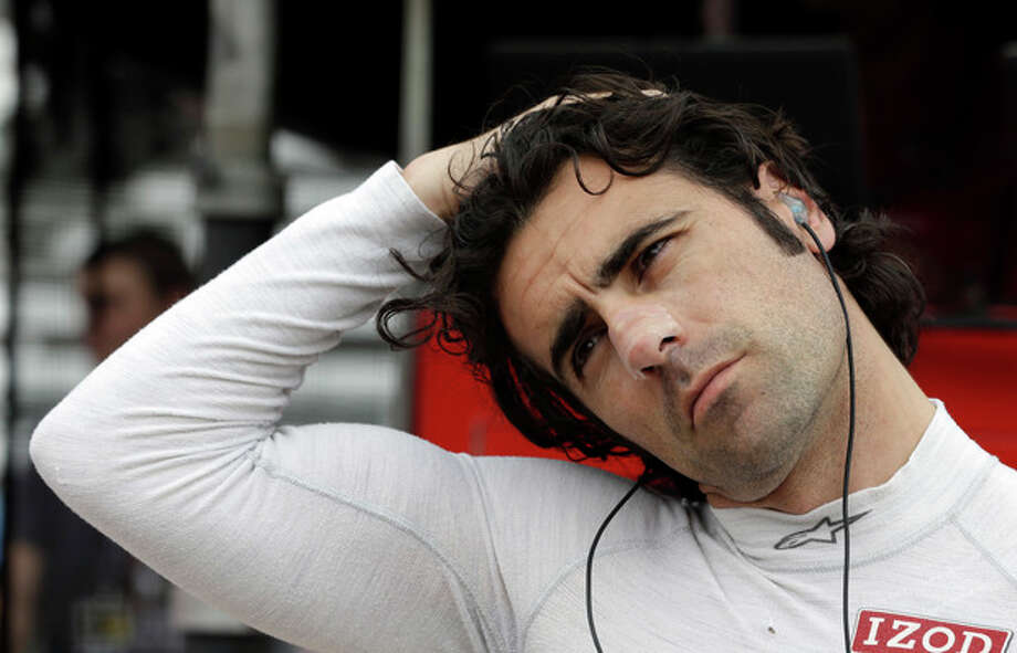 Dario Franchitti, of Scotland, stretches before climbing into his car during practice for the Indianapolis 500 auto race at the Indianapolis Motor Speedway in Indianapolis, Thursday, May 16, 2013. (AP Photo/Darron Cummings) / AP
