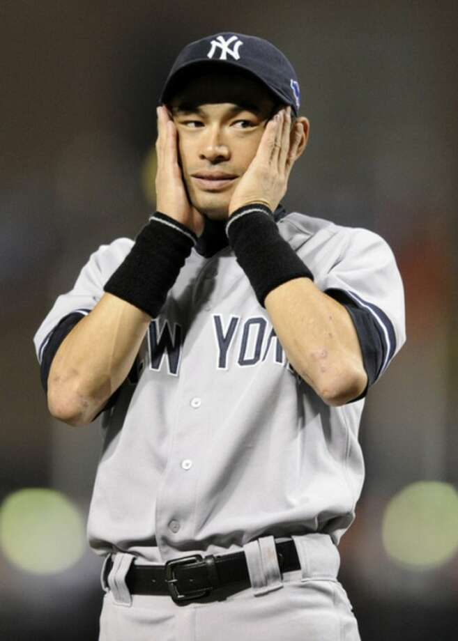 New York Yankees left fielder Ichiro Suzuki reacts as teammates are introduced before Game 1 of the American League division baseball series against the Baltimore Orioles on Sunday, Oct. 7, 2012, in Baltimore. (AP Photo/Nick Wass)