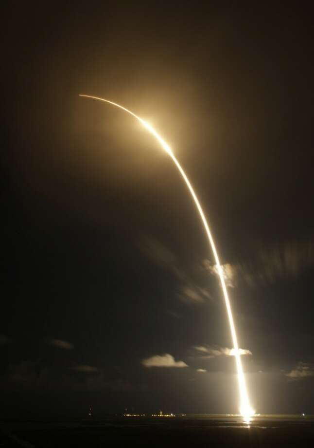 This time exposure photo shows the Falcon 9 SpaceX rocket lifting off from space launch complex 40 at the Cape Canaveral Air Force Station in Cape Canaveral, Fla. on Sunday, Oct. 7, 2012. The rocket is carrying supplies to the International Space Station. (AP Photo/Terry Renna)