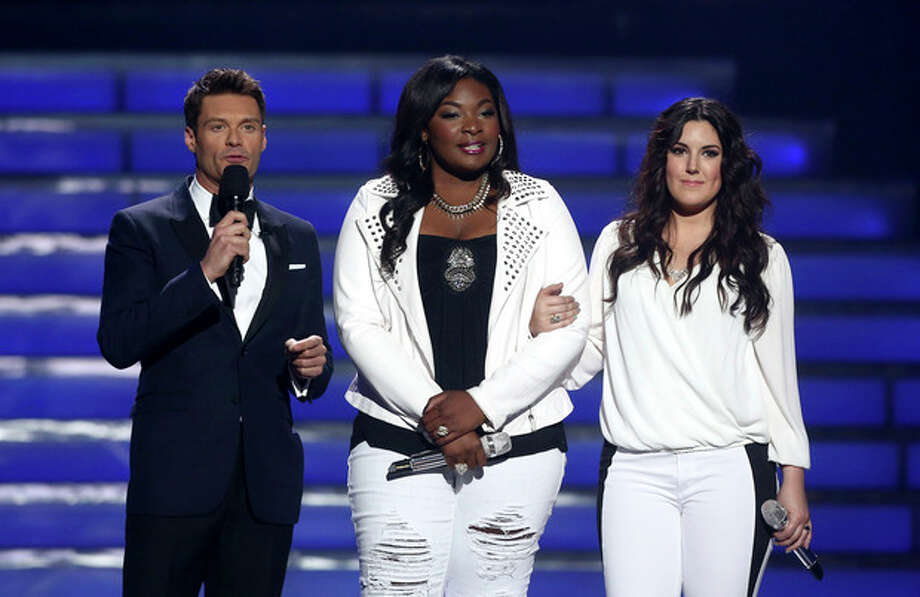 "Host Ryan Seacrest, left, and finalists Candice Glover, center, and Kree Harrison speak on stage at the ""American Idol"" finale at the Nokia Theatre at L.A. Live on Thursday, May 16, 2013, in Los Angeles. (Photo by Matt Sayles/Invision/AP) / Invision"