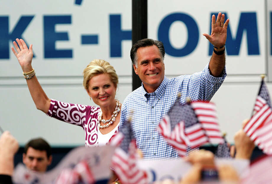 Republican presidential candidate and former Massachusetts Gov. Mitt Romney, right, waves as he arrives with his wife Ann at a campaign rally, Sunday, Oct. 7, 2012, in Port St. Lucie, Fla. (AP Photo/Lynne Sladky) / AP