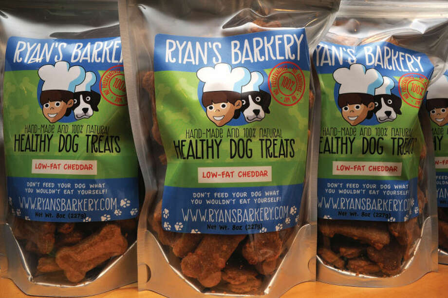 Some samples of 11-year-old Ryan Kelly's dog treats. The treats are available in three flavors — pumpkin apple, peanut butter and low-fat cheddar.