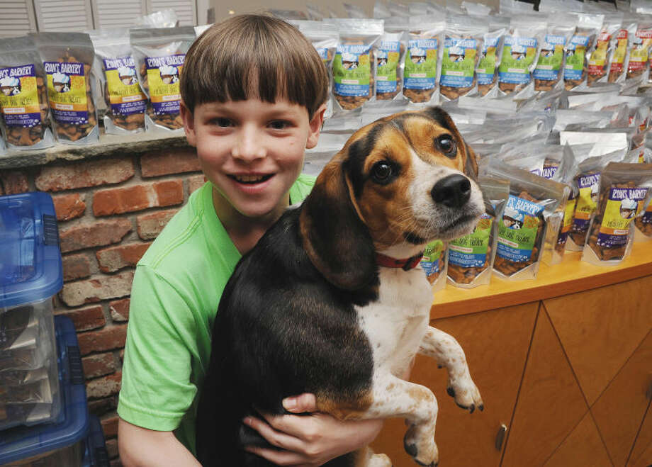 Eleven-year-old Ryan Kelly with his dog Barkley at his home in Stamford. Ryan has launched his own business making doggy treats.