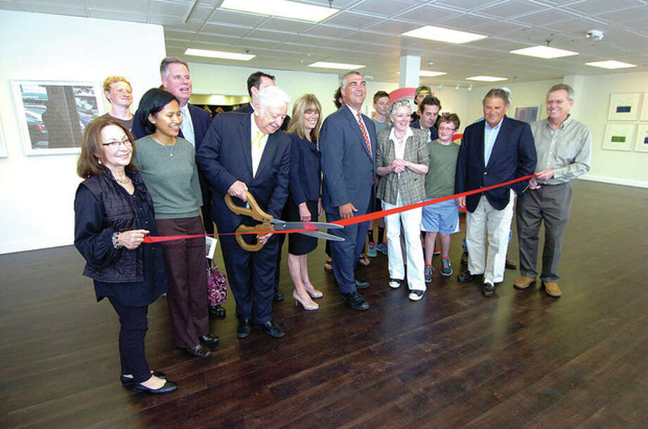 Hour Photo/Alex von Kleydorff Mayor Dick Moccia cuts the ribbon at the new Avenue gallery in Norwalk / 2013 The Hour Newspapers