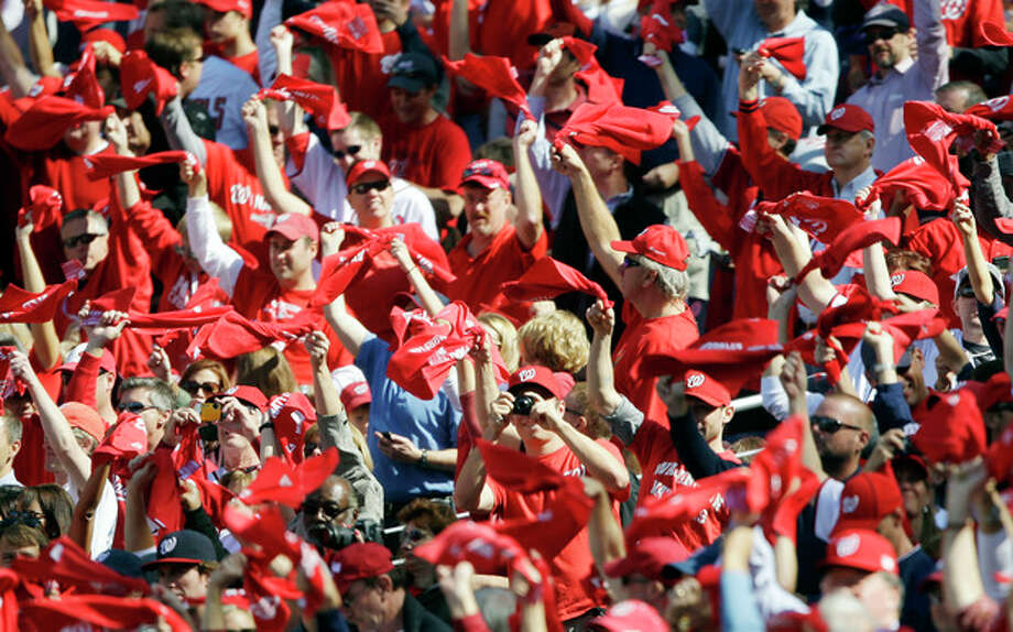 Fans wave towels and cheer before Game 3 of the National League division baseball series between the Washington Nationals and the St. Louis Cardinals on Wednesday, Oct. 10, 2012, in Washington. (AP Photo/Pablo Martinez Monsivais) / AP