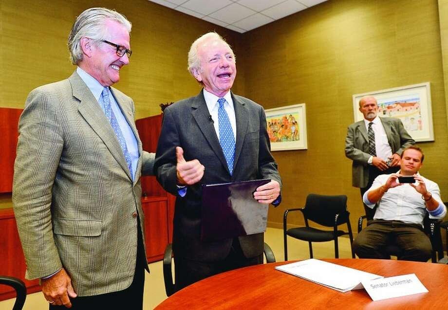 Outgoing U.S. Sen. Joseph Lieberman awards AmeriCares CEO and Wilton resident Curt Welling his 'Joe's Heores' award Wednesday, Oct. 10 at AmeriCares headquarters in Stamford.