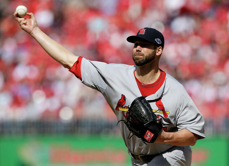 St. Louis Cardinals starting pitcher Chris Carpenter throws against the Washington Nationals in the first inning of Game 3 of the National League division baseball series on Wednesday, Oct. 10, 2012, in Washington. (AP Photo/Alex Brandon) / AP