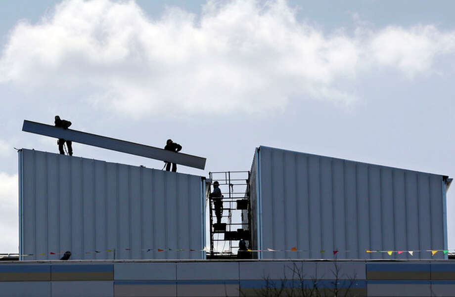 In this Wednesday, April 3, 2013, photo, construction is underway in Piscataway, N.J. The private Conference Board issues its April index of leading indicators on Friday, May 17, 2013. (AP Photo/Mel Evans) / AP