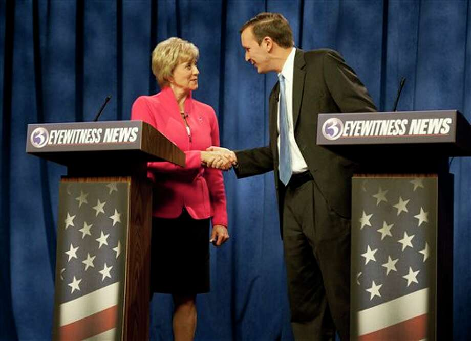 Republican candidate for U.S. Senate Linda McMahon, left, shakes hands with Democratic candidate for U.S. Senate Chris Murphy at the end of a live televised debate in Rocky Hill, Conn., Sunday, Oct. 7, 2012. The two are vying for the Senate seat now held by Joe Lieberman, an independent who's retiring. A recent Quinnipiac University poll shows the race is a dead heat. (AP Photo/Jessica Hill) / FR125654 AP