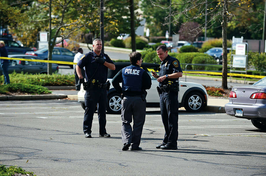 Norwalk police investigate a shooting at Super Stop and Shop where an elderly woman was shot in an apparent robbery Wednesday afternoon. Hour photo / Erik Trautmann / (C)2012, The Hour Newspapers, all rights reserved