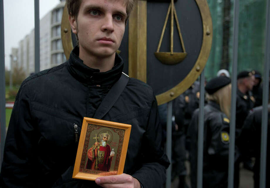 An Orthodox believer protests outside a court in Moscow, Wednesday. Oct. 10, 2012. Three members of the punk band Pussy Riot are set to make their case before a Russian appeals court that they should not be imprisoned for their irreverent protest against President Vladimir Putin. (AP Photo/Alexander Zemlianichenko) / AP