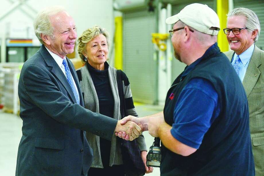 Outgoing U.S. Sen. Joseph Lieberman tours AmeriCares headquarters in Stamford with his wife, Hadassah, and Americares CEO, Curt Weller. Lieberman is retiring in November after 24 years in the Senate.