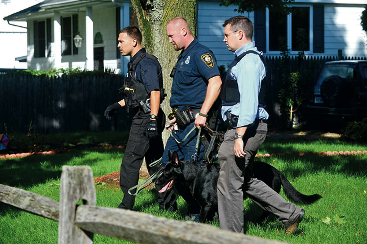 Norwalk police bring out the canine unit at Quaker St while they investigate a shooting at Super Stop and Shop where an elderly woman was shot in an apparent robbery Wednesday afternoon. Hour photo / Erik Trautmann