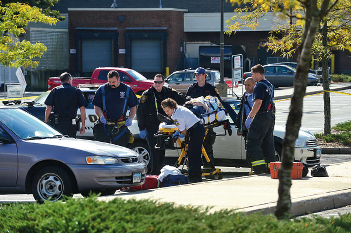 Emergency personnel respond to the scene of a shooting at Super Stop and Shop where an elderly woman was shot in an apparent robbery Wednesday afternoon. Hour photo / Erik Trautmann