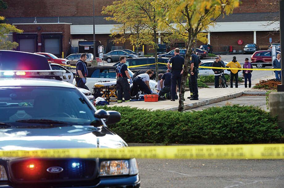 Emergency personnel respond to the scene of a shooting at Super Stop and Shop where an elderly woman was shot in an apparent robbery Wednesday afternoon. Hour photo / Erik Trautmann / (C)2012, The Hour Newspapers, all rights reserved
