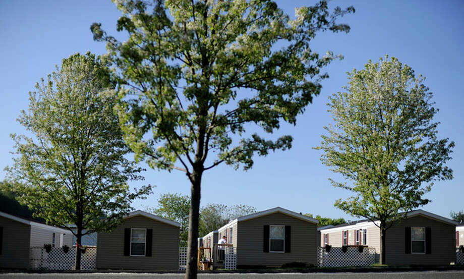 In this Sunday, May 5, 2013 photo, mobile homes for New York families displaced by Superstorm Sandy are seen in a row in New Milford, Conn. (AP Photo/Jessica Hill) / FR125654 AP