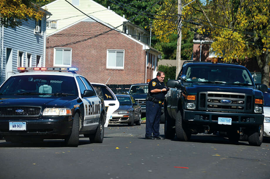 Norwalk police make a roadblock at Colonial Village while they investigate a shooting at Super Stop and Shop where an elderly woman was shot in an apparent robbery Wednesday afternoon. Hour photo / Erik Trautmann / (C)2012, The Hour Newspapers, all rights reserved