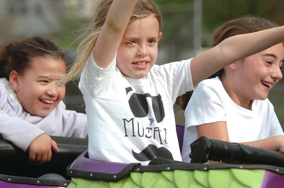 Hour Photo/Alex von Kleydorff 7.5 yr old Kayla Law has her hands in the air riding the Dragon Wagon at the Rowayton Carnival on Friday night / 2013 The Hour Newspapers