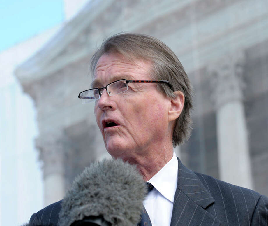 The University of Texas at Austin President Bill Powers speaks to reporters outside the Supreme Court in Washington, Wednesday, Oct. 10, 2012. The Supreme Court is taking up a challenge to a University of Texas program that considers race in some college admissions. The case could produce new limits on affirmative action at universities, or roll it back entirely. (AP Photo/Susan Walsh) / AP