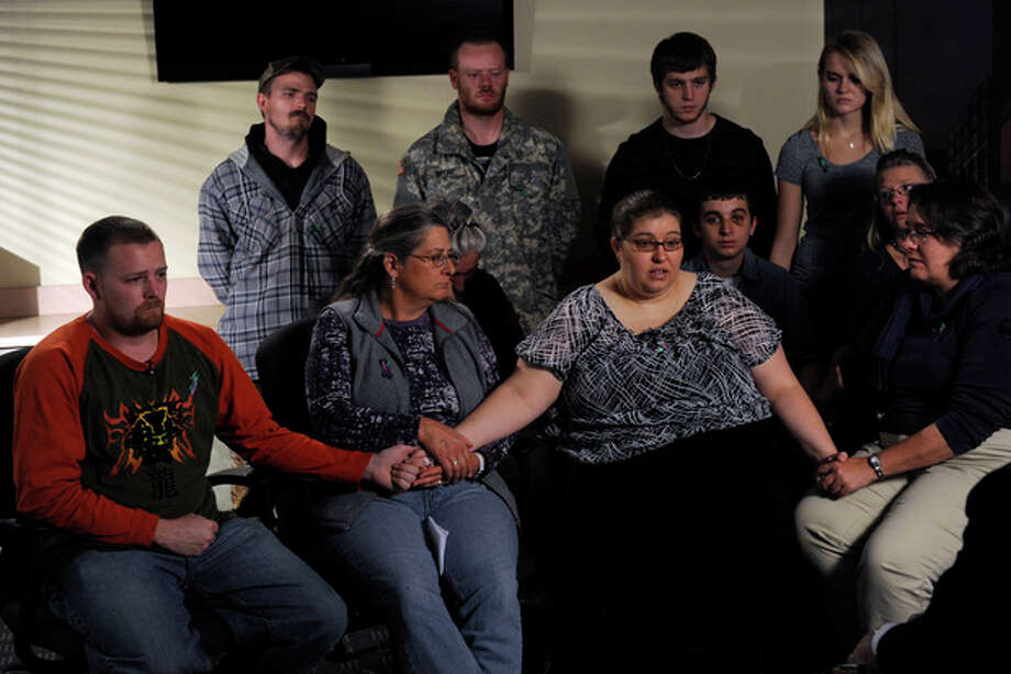 The family of Jessica Ridgeway gathers at the Westminster Police Department in Westminster, Colo., on Tuesday, Oct. 9, 2012, to talk about Jessica and ask for her safe return. In the front row from left are, Jessica's dad, Jeremiah Bryant, Jessica's great aunt, Gay Moore, Jessica's mother, Sarah Ridgeway, and Jessica's grandmother Christine Ridgeway. Jessica went missing Friday while on her way to school. (AP Photo/The Denver Post, Kathryn Scott Osler, Pool) / POOL The Denver Post
