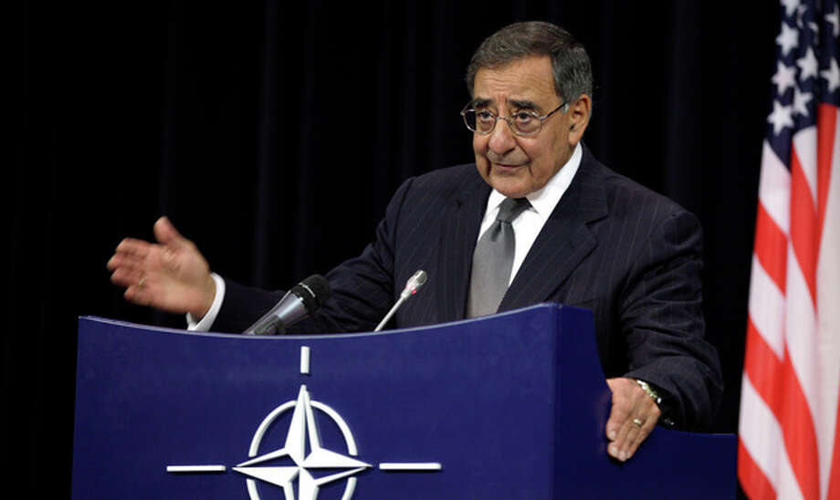 In this photo taken Oct. 10, 2012, Defense Secretary Leon Panetta speaks at NATO headquarters in Brussels. The US has sent troops to Jordan to bolster its military capabilities in the event Syria's civil war escalates, Panetta said Wednesday, reflecting U.S. concerns about the conflict spilling over allies' borders and about the security of Syria's chemical weapons arsenal. Speaking at a NATO conference of defense ministers, Panetta said the U.S. has been working with Jordan to monitor chemical and biological weapons sites in Syria and also to help Jordan deal with refugees pouring over the border from Syria. (AP Photo/Virginia Mayo) / AP