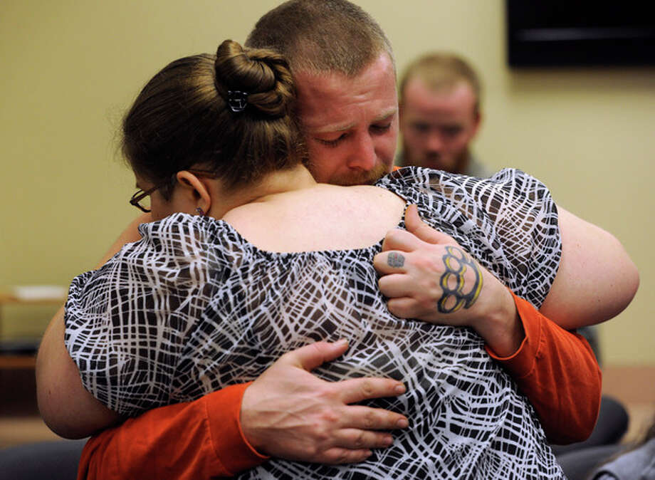 After giving the interview, Jessica's mother Sarah Ridgeway and Jessica's father, Jeremiah Bryant embrace at the Westminster Police Department in Westminster, Colo., on Tuesday, Oct. 9, 2012. The family of Jessica Ridgeway gathered to talk about Jessica and ask for her safe return. Jessica went missing Friday while on her way to school. (AP Photo/The Denver Post, Kathryn Scott Osler, Pool) / POOL The Denver Post