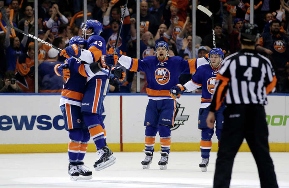 New York Islanders defenseman Brian Strait (37) lifts up New York Islanders right wing Colin McDonald (13) after McDonald scored against the Pittsburgh Penguins in the first period of Game 6 of a first-round NHL Stanley Cup playoff hockey series in Uniondale, N.Y., Saturday, May 11, 2013. (AP Photo/Kathy Willens) / AP