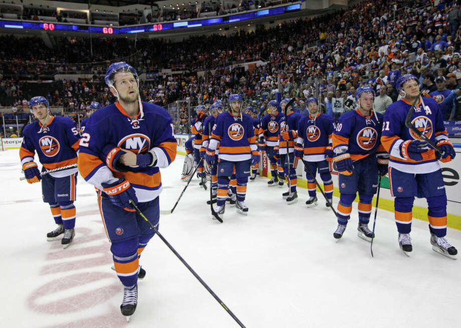 New York Islanders defenseman Mark Streit (2) and teammates react after the Pittsburgh Penguins defeated Islanders 4-3 in overtime of Game 6 of a first-round NHL Stanley Cup playoff hockey series, in Uniondale, N.Y., Saturday, May 11, 2013. The Penguins advanced to the Eastern Conference semifinals. (AP Photo/Kathy Willens) / AP