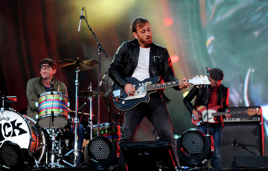 FILE - In this Sept. 29, 2012 file photo, guitarist Dan Auerbach, center, and drummer Patrick Carney of The Black Keys perform at the Global Citizen Festival in Central Park, in New York. At the Austin City Limits Music Festival, about a third of the nearly 130 bands on a lineup that includes the Red Hot Chili Peppers, the Black Keys and Jack White will have their sets broadcast on YouTube. That's a record for the three-day festival that starts Friday, Oct. 12, 2012. (Photo by Evan Agostini/Invision/AP, File) / Invision