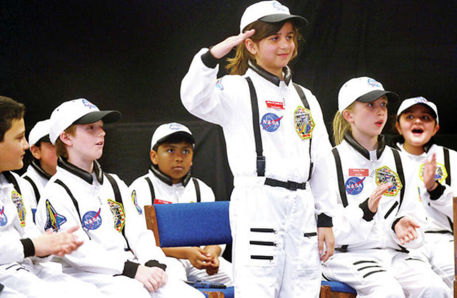 Commander Olivia DiRaffaele salutes the crowd during The Columbus Young Astronauts program landing ceremony for their 18th mission, Memora Septem, which honored the last flight of the Space Shuttle Columbia Friday morningHour photo / Erik Trautmann / (C)2013, The Hour Newspapers, all rights reserved