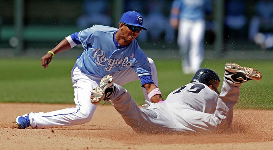 New York Yankees' Chris Stewart (19) is caught stealing second by Kansas City Royals shortstop Alcides Escobar during the seventh inning of an American League MLB baseball game Sunday, May 12, 2013, in Kansas City, Mo. (AP Photo/Charlie Riedel) / AP