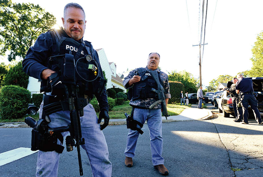 Norwalk police respond to a man with a weapon hold up in his house at 4 Hillside Street Thursday. Hour photo / Erik Trautmann