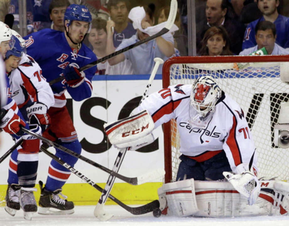 New York Rangers left wing Chris Kreider (20) reacts as Washington Capitals goalie Braden Holtby (70) makes a save in the first period of Game 6 of their NHL Stanley Cup hockey playoff series in New York, Sunday, May 12, 2013. (AP Photo/Kathy Willens) / AP
