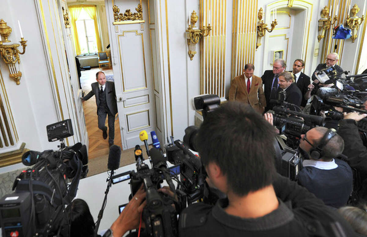 """Peter Englund, permanent secretary of the Royal Swedish Academy, arrives to announce that Chinese writer Mo Yan has been named the winner of the 2012 Nobel Prize in literature, Thursday Oct. 11, 2012 in Stockholm. The Swedish Academy, which selects the winners of the prestigious award, in Thursday praised Mo's """"hallucinatoric realism"""" saying it """"merges folk tales, history and the contemporary."""" As with the other Nobel Prizes, the prize is worth 8 million kronor, or about $1.2 million. (AP Photo/Fredrik Sandberg) SWEDEN OUT"""