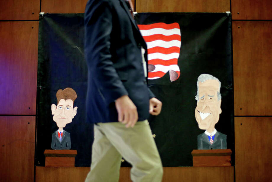 A banner made by a local middle school depicting Republican vice presidential candidate, Rep. Paul Ryan, R-Wis., at left, and Vice President Joe Biden, at right, hangs on the wall inside the media center ahead of Thursday's vice presidential debate, Wednesday, Oct. 10, 2012, at Centre College in Danville, Ky. (AP Photo/David Goldman) / AP
