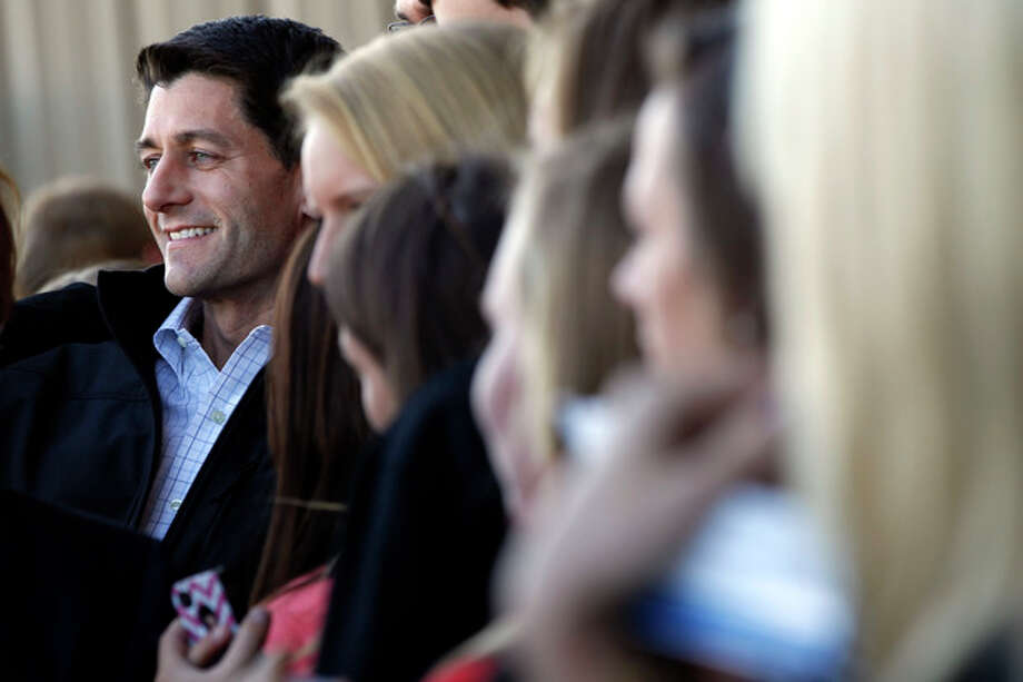 Republican vice presidential candidate, Rep. Paul Ryan, R-Wis., poses for pictures with supporters as he arrives at the Blue Grass airport, Wednesday, Oct. 10, 2012 in Lexington, Ky. (AP Photo/Mary Altaffer) / AP