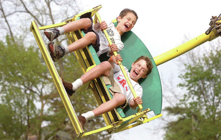 Hour Photo/Alex von KleydorffRowayton school third graders, 9-year-old old Jack Pavia, and 9-year-old old Theo Diamandis, get whipped around by the Cobra at the Rowayton Carnival on Friday night. / 2013 The Hour Newspapers