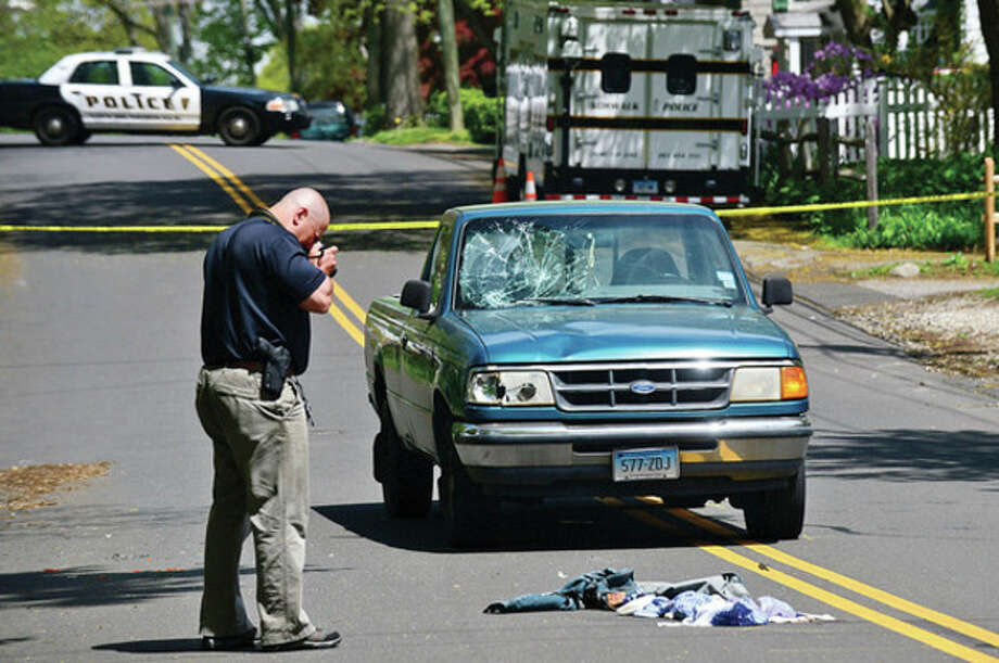 Norwalk police investigate an accident wher a pedestrian was strcuk by a motor vehicle on George Ave Friday morning.Hour photo / Erik Trautmann / (C)2013, The Hour Newspapers, all rights reserved