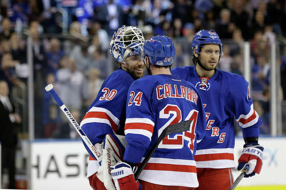 New York Rangers right wing Ryan Callahan (24) congratulates New York Rangers goalie Henrik Lundqvist (30) of Sweden as New York Rangers defenseman Steve Eminger (44) joins them celebrating the Rangers 1-0 victory over the Washington Capitals in Game 6 of their NHL Stanley Cup hockey playoff series in New York, Sunday, May 12, 2013. The Rangers evened the series at 3-3, forcing a Game 7 in Washington Monday. (AP Photo/Kathy Willens) / AP