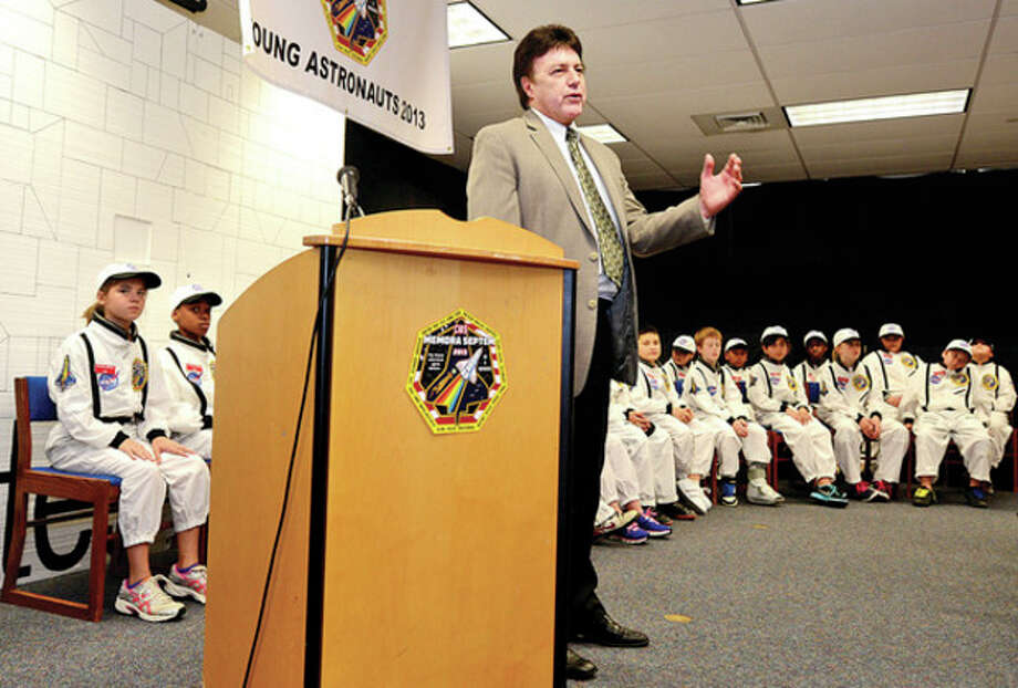 Interim Superintendent of Schools Tony Daddona welcomes the crew during The Columbus Young Astronauts program landing ceremony for their 18th mission, Memora Septem, which honored the last flight of the Space Shuttle Columbia Friday morningHour photo / Erik Trautmann / (C)2013, The Hour Newspapers, all rights reserved