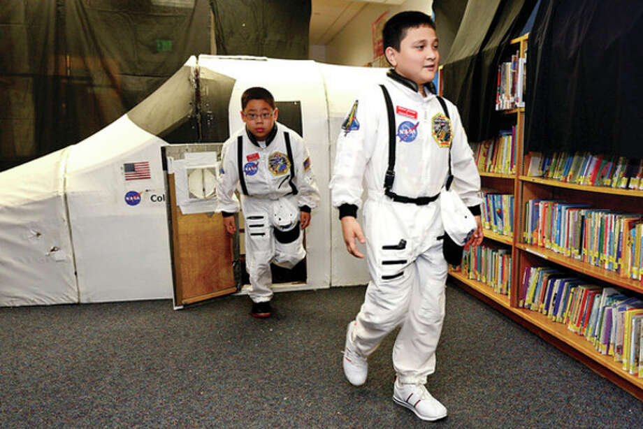 Hour photo / Erik TrautmannPayload specialist Mathew Alvarado and Mission specialist Johnny Liao exit the shuttle. / (C)2013, The Hour Newspapers, all rights reserved