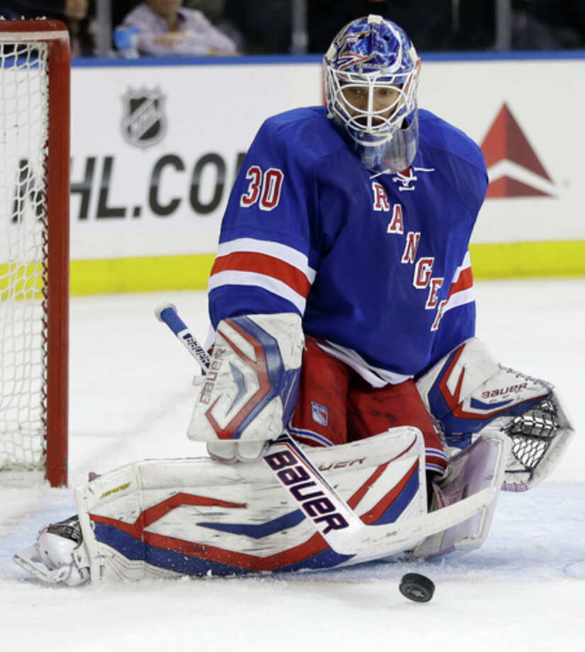 New York Rangers goalie Henrik Lundqvist (30), of Sweden, makes a save in the third period of Game 6 of their NHL Stanley Cup hockey playoff series against the Washington Capitols in New York, Sunday, May 12, 2013. The Rangers evened the series at 3-3 with a 1-0 shutout, forcing a Game 7 in Washington, Monday. (AP Photo/Kathy Willens) / AP