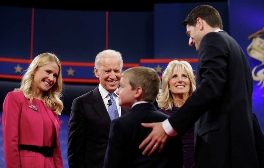 Vice President Joe Biden, center, and his wife Jill Biden, meet with Republican vice presidential candidate, Rep. Paul Ryan, R-Wis., right, his wife Janna Ryan, left, and son Charlie Ryan, center, on stage after the vice presidential debate, at Centre College in Danville, Ky., Thursday, Oct. 11, 2012. (AP Photo/Pablo Martinez Monsivais) / AP