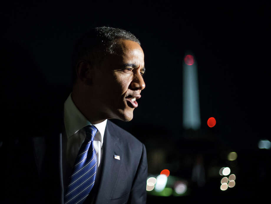 """Remarking on the vice presidential debate, President Barack Obama tells reporters, """"I think Joe Biden did great. I couldn't be prouder,"""" as he returns to the White House in Washington after a day of campaign events in Miami, Thursday night, Oct. 11, 2012. (AP Photo/J. Scott Applewhite) / AP"""