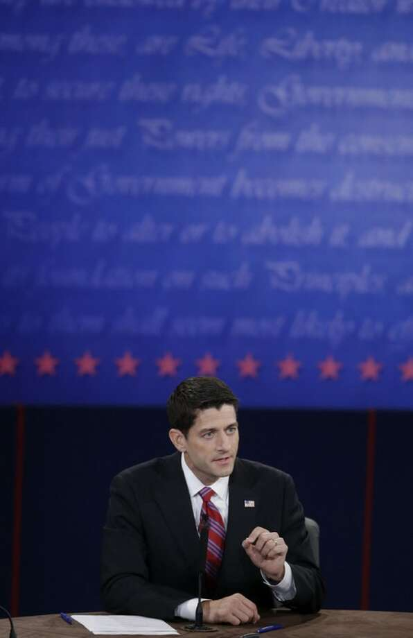 Republican vice presidential nominee Rep. Paul Ryan of Wisconsin answers a question during the vice presidential debate at Centre College, Thursday, Oct. 11, 2012, in Danville, Ky. (AP Photo/Mark Humphrey)