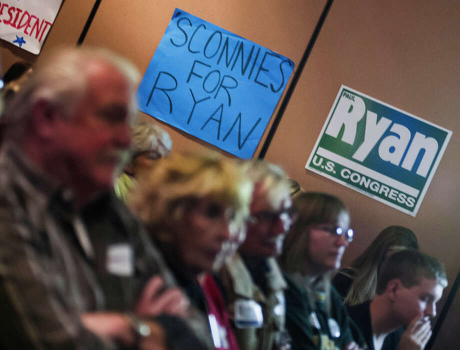 Supporters of Republican vice presidential nominee Rep. Paul Ryan, of Wisconsin, gather at the Holiday Inn Express in Janesville, Wis. to watch his debate with Vice President Joe Biden on Thursday, Oct. 11, 2012. (AP Photo/The Janesville Gazette, Mark Kauzlarich) / The Janesville Gazette