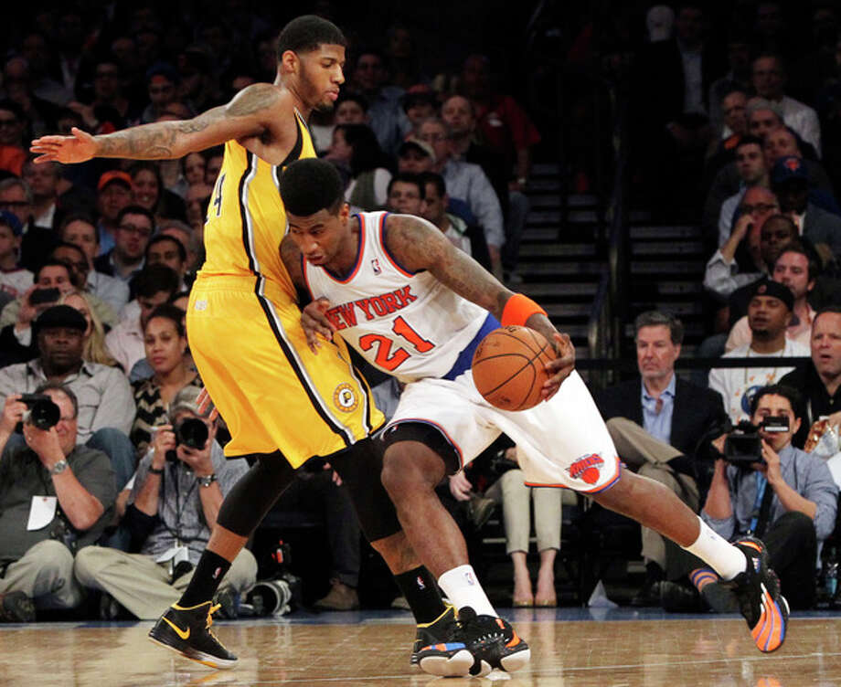 New York Knicks' Iman Shumpert drives past Indiana Pacers' Paul George in the first half of Game 2 of their NBA basketball playoff series in the Eastern Conference semifinals at Madison Square Garden in New York, Tuesday, May 7, 2013. The Knicks won 105-79. (AP Photo/Mary Altaffer) / AP