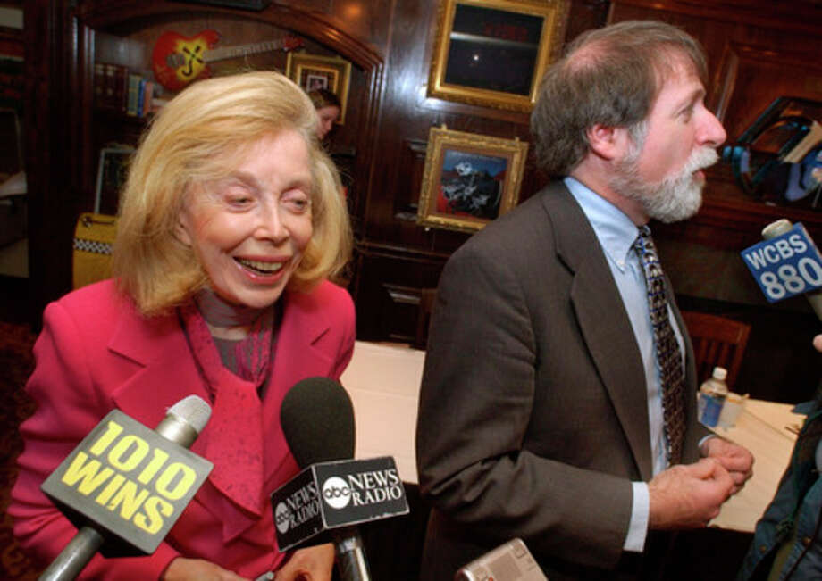 "FILE - In this Jan. 16, 2004 file photo, psychologist Dr. Joyce Brothers, left, and Bruce Spizer, author of ""The Beatles are Coming,"" are interviewed at a news conference in New York. Brothers died Monday, May 13, 2013, in New York City, according to publicist Sanford Brokaw. She was 85. (AP Photo/Richard Drew, File) / AP"
