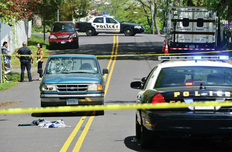 Norwalk police investigate an accident where a pedestrian was strcuk by a motor vehicle on George Ave Friday morning.Hour photo / Erik Trautmann / (C)2013, The Hour Newspapers, all rights reserved