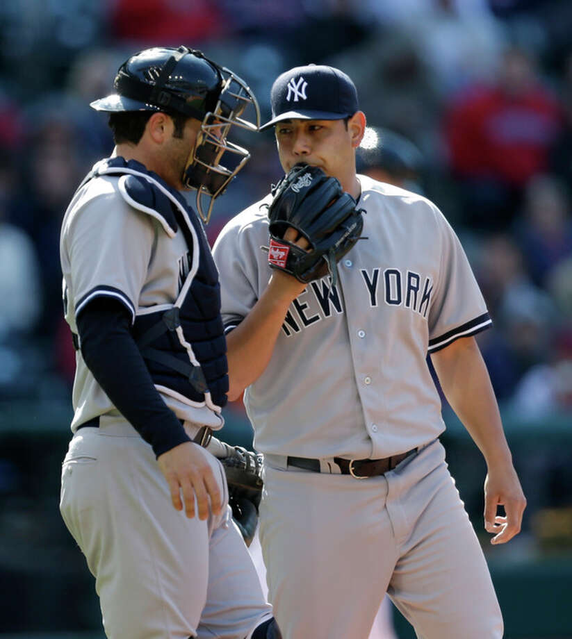 New York Yankees starting pitcher Vidal Nuno, right, talks with catcher Austin Romine in the fifth inning in the second game of a baseball doubleheader against the Cleveland Indians, Monday, May 13, 2013, in Cleveland. (AP Photo/Tony Dejak) / AP